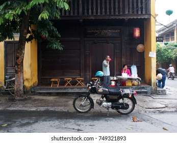 October 14, 2017, elder VIETNAMESE people relaxing by traditional breakfast shop on the peaceful street in the well known world cultural heritage place, HOI AN, cute and peaceful town in VIETNAM