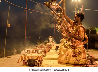 October 14,2017. Varanasi,Uttar Pradesh,India.Young Priests performing Early morning Ganga Aarti puja celebration at Varanasi ghat before Sunrise.