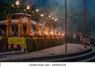 October 14,2017. Varanasi,Uttar Pradesh,India.Young Priests performing Early morning Ganga Aarti puja celebration at Assi ghat .