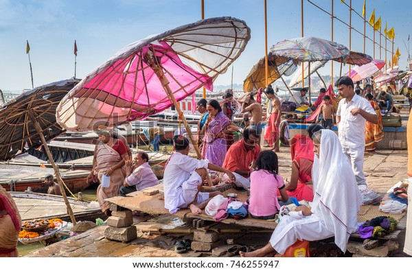 October 14,2017.Varanasi,India.  Diverse group of people are sitting and making different types of activities at Varanasi ghat. Selective focus is used.