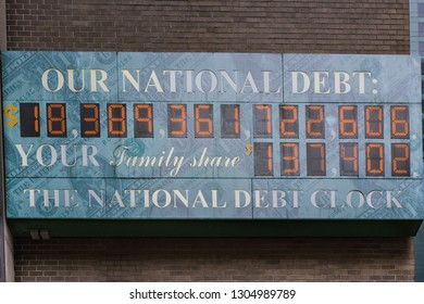 """October 15, 2015- New York, NY/USA: Sign reading """"Our National Debt- The National Debt Clock"""" ticks off numbers correlated to the USA's national debt in real time."""