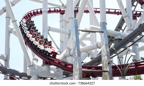 October 15, 2017. Tourists scream while riding the red, curved, rails of the Battlestar Galactica Human vs. Cyclon roller coaster. Universal Studios Sentosa, Singapore.