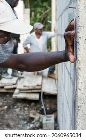 October 16, 2020 La Cienaga, Dominican Republic. image of a Haitian and Dominican construction workers using a clear tube to level roof and set floors in a small Caribbean town in the mountains.