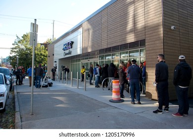 October 17, 2018: Halifax, Nova Scotia: Patrons and media wait in line outside the Clyde Street NSLC on the morning the cannabis becomes legal in Canada