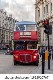 October 19, 2014: Famous double decker bus, symbol of London, on a street in London, England, UK
