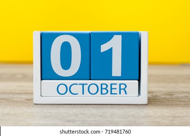 October 1st . First day, October 1 blue wooden calendar on yellow abstract background. Autumn day