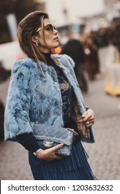 October 2, 2018: Paris, France - Fashionable girl wearing a Chanel bag outside a fashion show during Paris Fashion Week  - PFWSS19