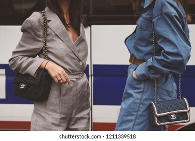 October 2, 2018: Paris, France - Fashionable girls with Chanel hand bags during Paris Fashion Week  - PFWSS19