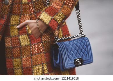 October 2, 2018: Paris, France - Girl wearing a stylish Chanel hand bag after a fashion show during Paris Fashion Week  - PFWSS19