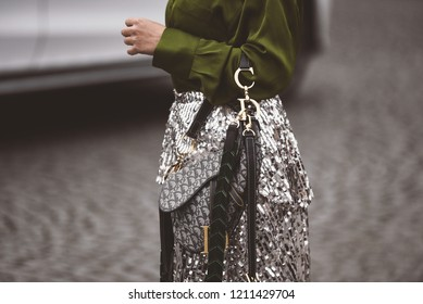 October 2, 2018: Paris, France - Girl wearing a stylish Dior hand bag after a fashion show during Paris Fashion Week  - PFWSS19