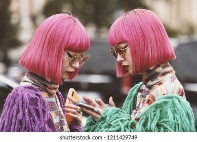 October 2, 2018: Paris, France - Twins Aya Amiaya and Ami Amiaya outside a fashion show during Paris Fashion Week  - PFWSS19