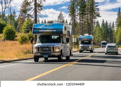 October 2, 2018 Yosemite National Park / CA / USA - Cruise America rented RVs travelling on the highway on a sunny fall day