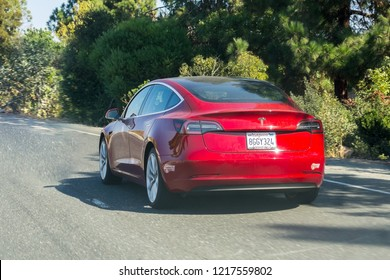 October 20, 2018 Fremont / CA / USA - The new Model 3 Tesla driving on the freeway in east San Francisco bay area