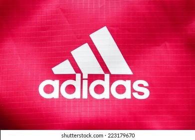 """October 2014 - BERLIN: the logo of the brand cloth bags """"Adidas"""","""