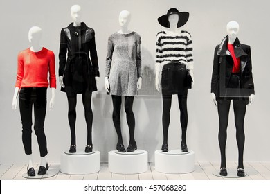 OCTOBER, 2014., NOVI SAD, SERBIA - Five mannequins in a clothing store dressed in a fall style