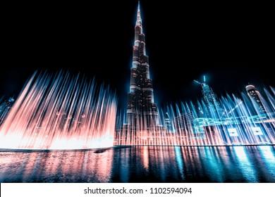 October 2015 - Dubai, UAE - Dubai show fountain next to Burj Khalifa