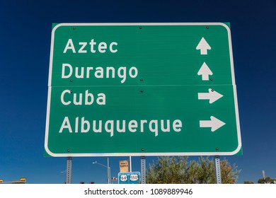 OCTOBER 2017 - American Road Signs along roadways - shows directions to Durango, Cuba, Albuquerque, and Aztec along Colorado New Mexico roads