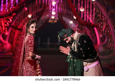 october 2020 delhi,india Gorgeous  stunning Indian bride and groom wearing traditionally dressed are posing  on their wedding ceremony