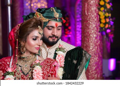 october 2020 delhi,india Gorgeous  stunning Indian bride and groom wearing traditionally dressed are posing  on their wedding ceremony with selective focous and blur background