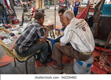 October 21, 2016 Medellin, Colombia: men playing chess in the street flea-market in the Prado area of the second largest city of the country