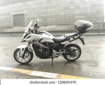October 21,2018. Klong Toey,Bangkok,Thailand.Sunday morning on the departure day with a motorcycle BigBike HondaNC750x encountered obstacle is rain and for the safety.Should park before leaving again.