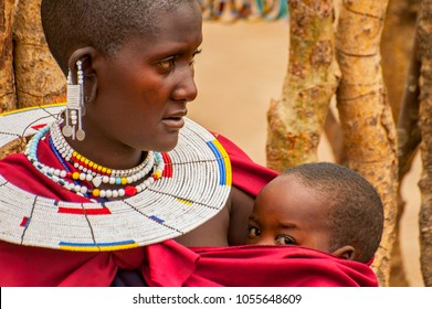 October 22, 2005. Portrait of a Maasai Woman from Kenya with Colorful African Bead Necklace Jewelry around her Neck. Massai Mara, Kenya.