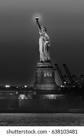 OCTOBER 23, 2016, Statue of Liberty sunset. NYC harbor, Manhattan - shot from Brooklyn in Black and White