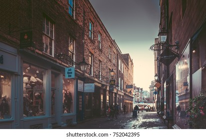October 23, 2017, Cambridge, England : Street with college view and people on the street.