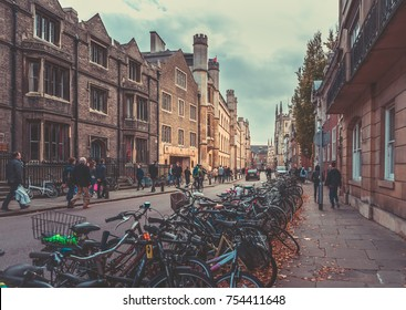 October 23, 2017, Cambridge, England : Street with college view and lots of Tourists and shoppers walking the street.