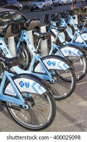 October 25, 2014, Rack of Divvy bicycles waiting for rental, on Damen ave at Leleand Ave, Chicago, Illinois.