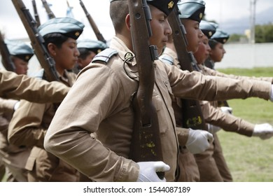 October 25, 2019 San Marcos, Guatemala-Students of the Adolfo V. Hall Institute with a daily uniform or fatigue parading - young aspirants to be military - Guatemalan army, infantry group.