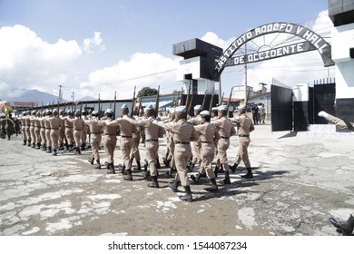 October 25, 2019 San Marcos, Guatemala- Students of the Adolfo V. Hall Institute with a daily uniform or fatigue parading - young aspirants to be military - Guatemalan army, infantry group.