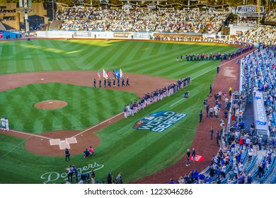 OCTOBER 26, 2018 - DODGER STADIUM, LOS ANGELES, CALIFORNIA, USA - giant US Flag is unfurled for World Series Game 3 opening ceremonies of Los Angeles Dodgers versus Boston Red Sox.