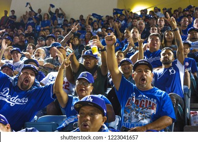 OCTOBER 26, 2018 - LOS ANGELES, CALIFORNIA, USA - DODGER STADIUM: fans celebrate as LA Dodgers defeat Boston Red Sox 3-2 in game 3, the longest game in World Series History