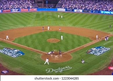 OCTOBER 26, 2018 - LOS ANGELES, CALIFORNIA, USA - DODGER STADIUM: Outfielder Cory Bellinger throws out Boston's Ian Kinsler as Austin Barnes tags him out