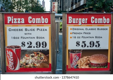 October 27, 2008- New York, New York/USA: Two similar signs on sidewalk advertise a fast food restaurant's combination (combo) meals. One offers a pizza combo, the other a hamburger combo.