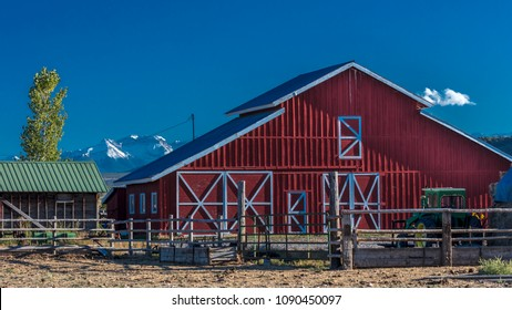OCTOBER 3, 2017 - Red Barn with San Juan Mountains in background outside of Ridgway, Colorado