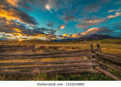 OCTOBER 3, 2018, RIDGWAY COLORADO USA - Sunrise on worm western fence in front of San Juan Mountains in Old West of Southwest Colorado near Ridgway