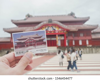 October 30,2019 : Naha,Okinawa : admission ticket of the Shuri Castle in Naha Okinawa,Japan one of the World Heritage Sites  by UNESCO with background of Shurijo  before fire engulfs