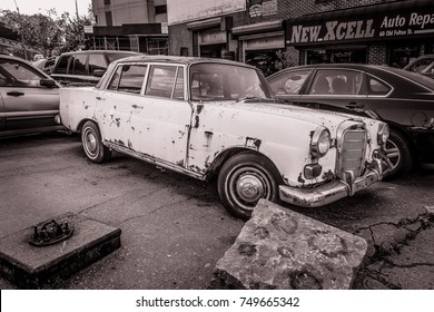 October 4 2017, Abandoned, old and rusty Mercedes Benz car on street of Brooklyn, New York
