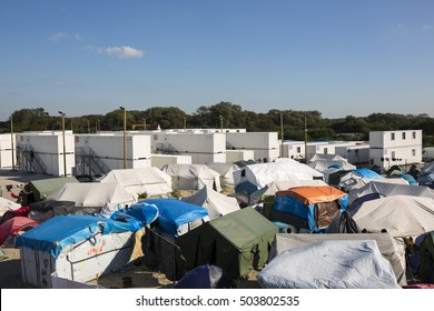 "OCTOBER 5, 2016 - CALAIS, FRANCE: Makeshift Refugee camp called ""Jungle"" in Calais, France. Concept homeless, refugee, aid, humanity, humanitarian."