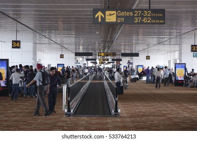 October 5, 2016. View of the hall and the moving walkway / escalator leading to the gates in the terminal of an international airport, New Delhi, India