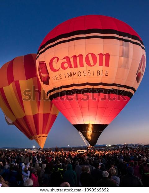 OCTOBER 7, 2017 - Albuquerque, New Mexico - Colorful Hot Air Balloons at Morning Glow Event at the Albuquerque Balloon Fiesta features Canon Cameras Balloon