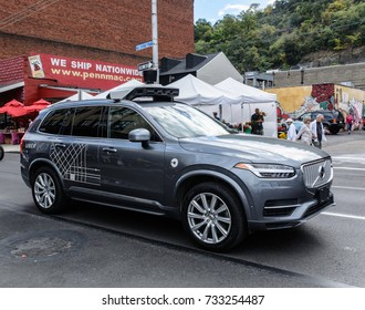 October 7, 2017, Pittsburgh Pennsylvania - A Uber autonomous driving car, with back-up human driver aboard, navigates the Pittsburgh Pennsylvania Strip District on a busy Saturday morning.