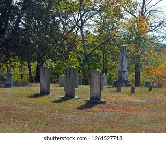 October 7, 2017 Route 2A Maine, USA Worn Granite headstones in a Late 1800's cemetery on Route 2A near Holden, Maine in autumn