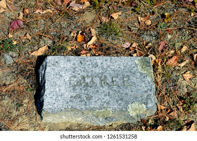 October 7, 2017 Route 2A Maine, USA Worn Granite father headstone in a Late 1800's cemetery on Route 2A near Holden, Maine in autumn marks a Father's grave