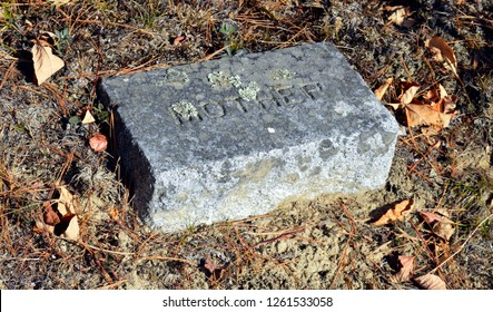 October 7, 2017 Route 2A Maine, USA Worn Granite mother headstone in a Late 1800's cemetery on Route 2A near Holden, Maine in autumn marks a mother's grave