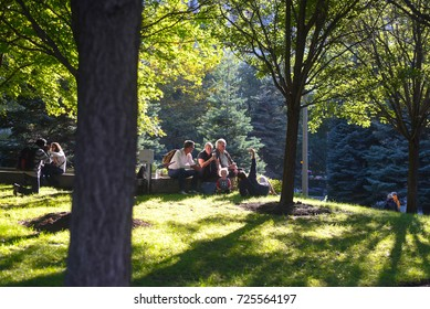 October 8, 2016 - People hanging out in a sunny afternoon in Grant Park. Chicago, Illinois