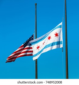 October 8 2017. Chicago, Illinois, and USA flags flag flying at half-staff to mourn at Navy Pier, Chicago, IL, USA.
