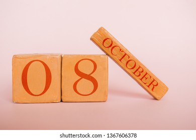 october 8th. Day 8 of month, handmade wood cube calendar  on modern color background. autumn month, day of the year concept.